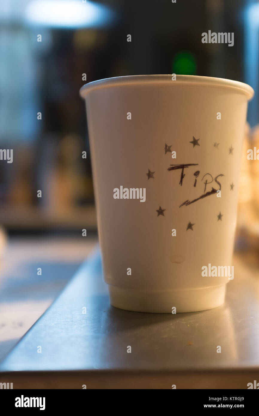A Paper Cup With The Word Tips Written On It In A Coffee Shop Stock Photo Alamy