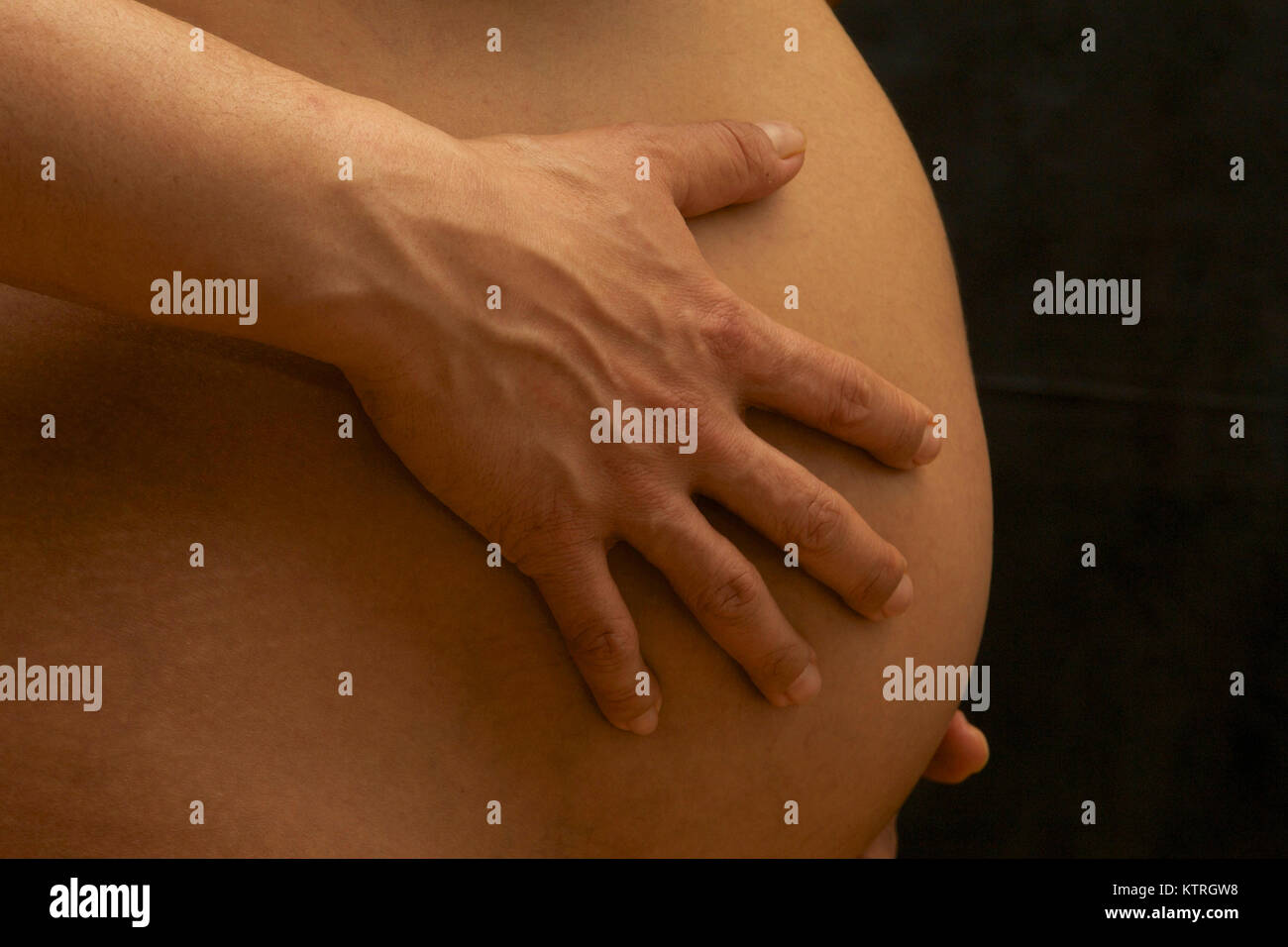 Pregnancy: Pregnant belly of a european woman. - Stock Image