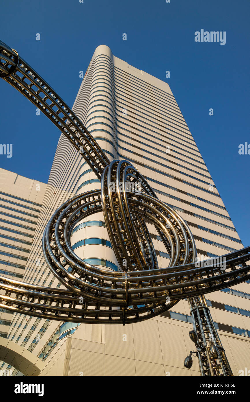 Yokohama, Japan - June 15, 2017: Futuristic stainless steel construction and the Landmark tower on Queen's Square - Stock Image
