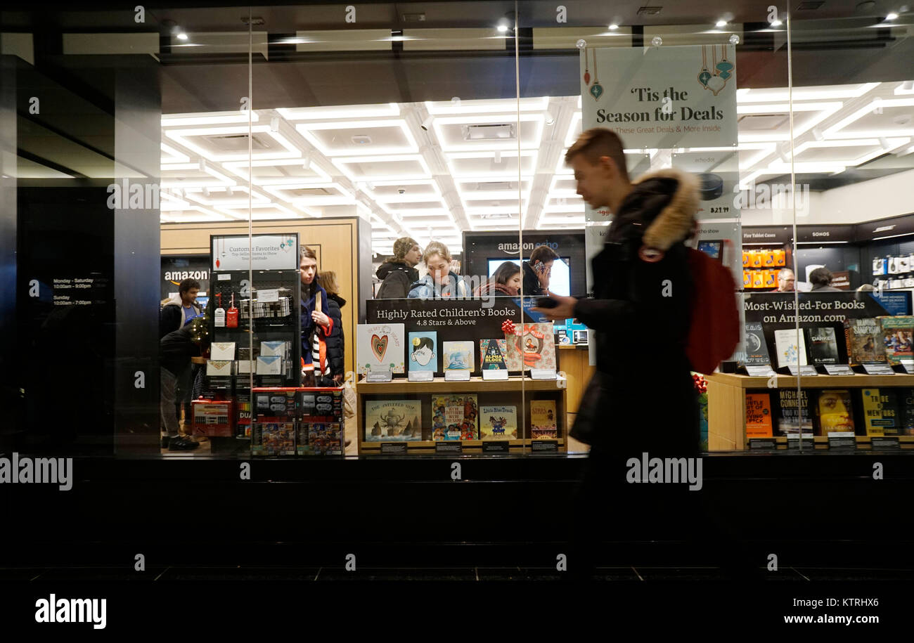 Customers shop and browse for Christmas gifts in the Amazon Books in the Time Warner Center in New York on Thursday December 21 2017. & Customers shop and browse for Christmas gifts in the Amazon Books in ...