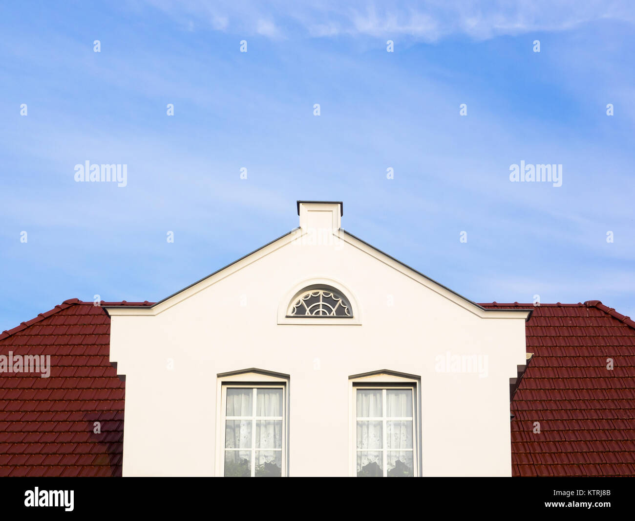 White house with three-level gable and copy space - Stock Image