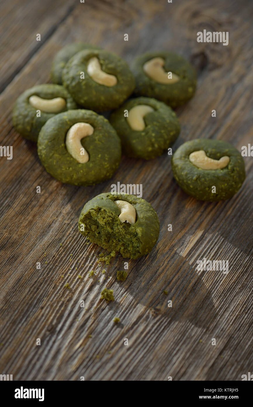 Home-made Japanese Matcha cookies, chewy ground green tea cookies artistic still life - Stock Image