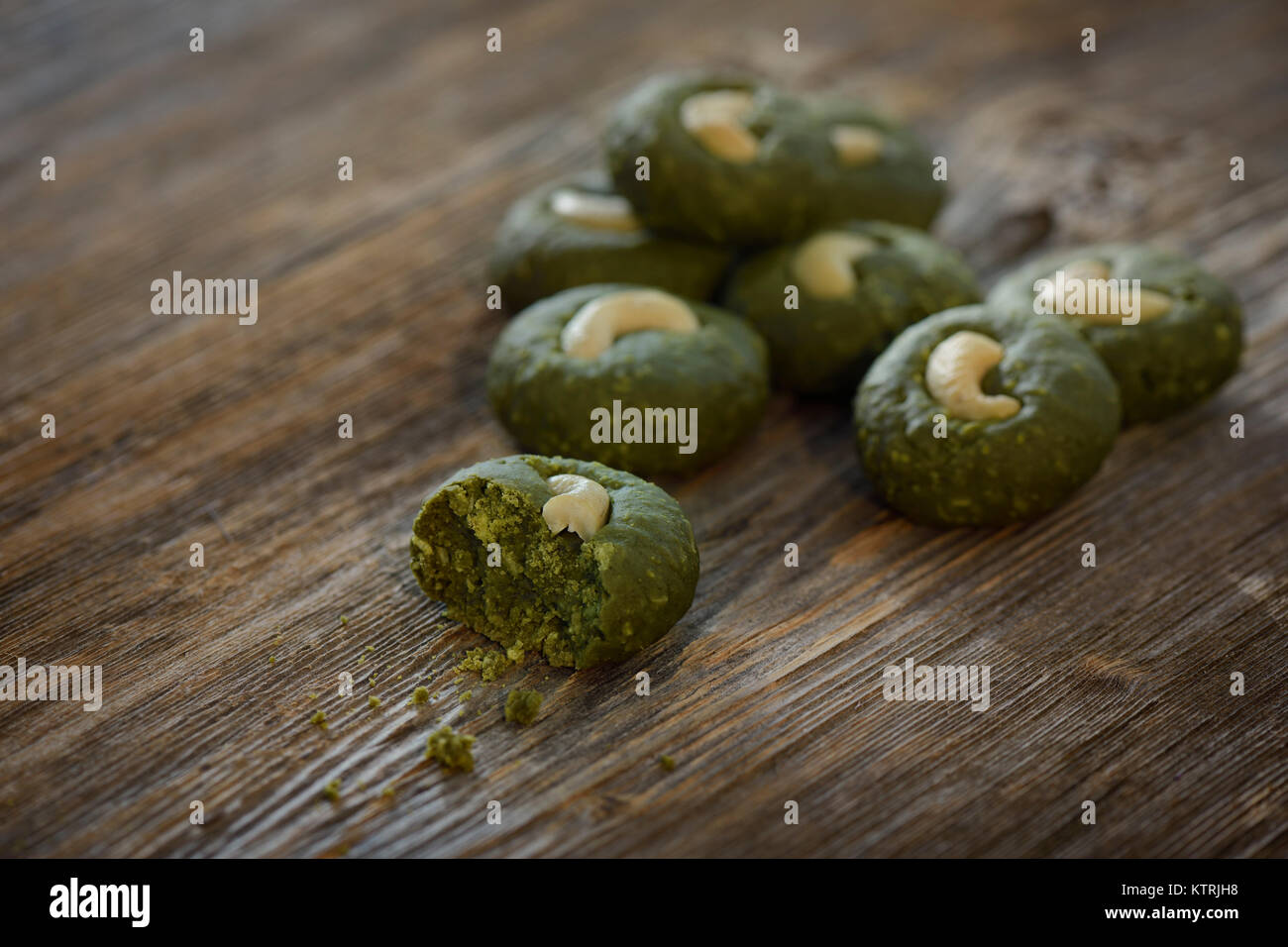 Artistic food still life of home-made Japanese Matcha green tea cookies on rustic wooden background - Stock Image