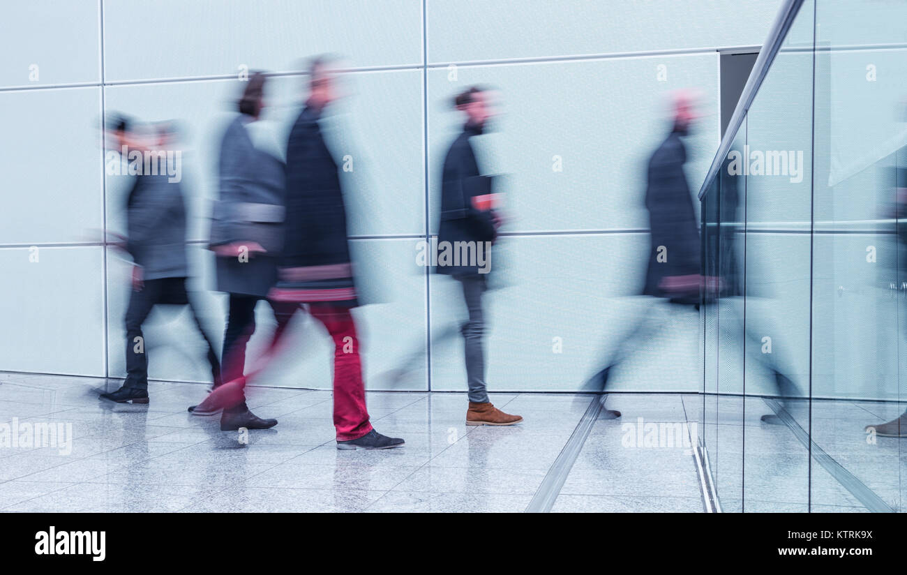 abstract image of business people on floor of a modern business center - Stock Image