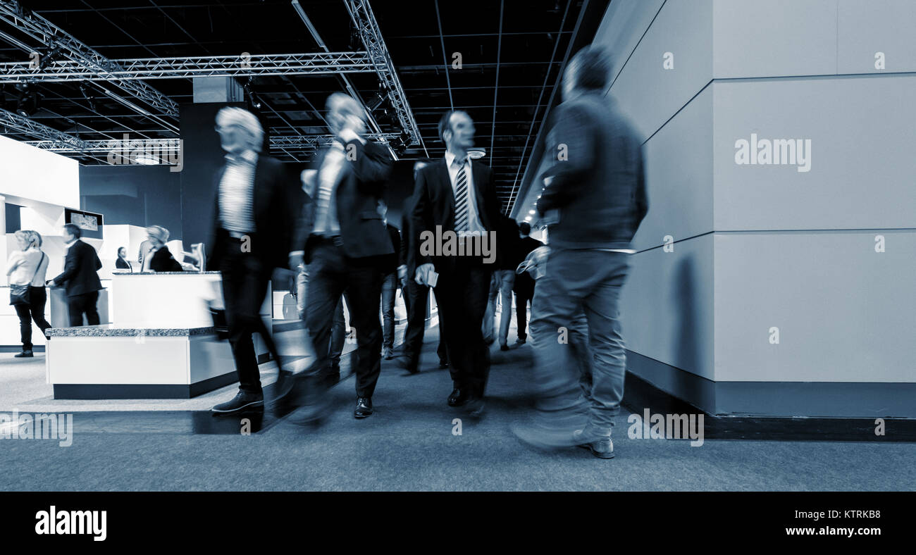 businesspeople walking in the corridor of an Exhibition - Stock Image