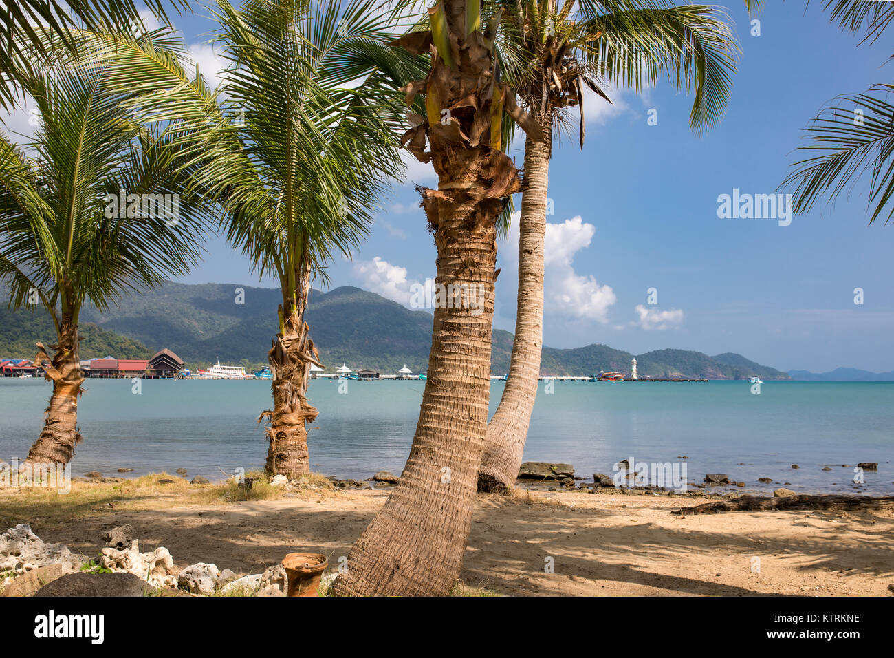 Thailand, The island Koh Chang, panoramic coast view, palms and rainforest plants, hills and blue sea. Nature in Stock Photo