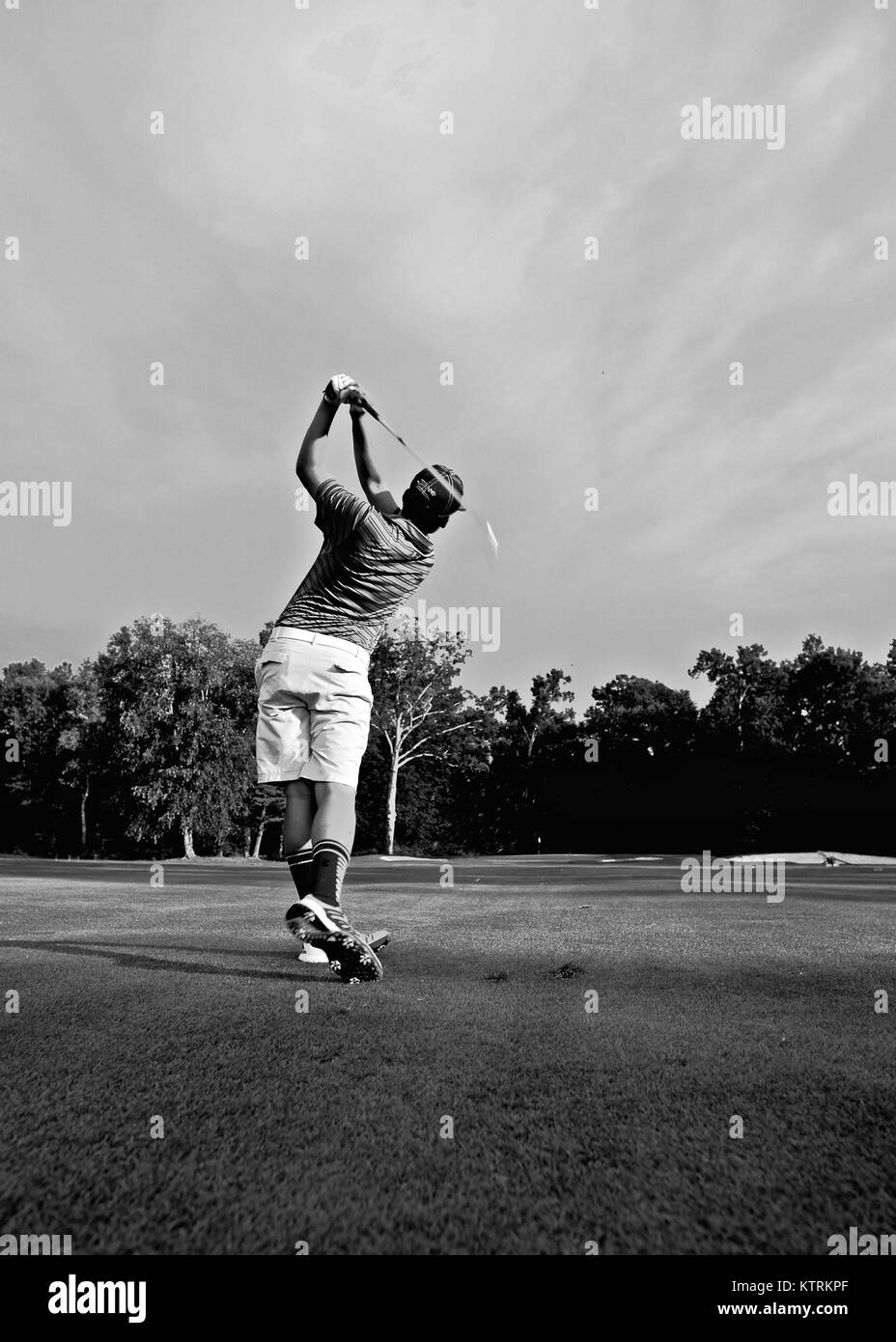 My son the Golfger. - Stock Image