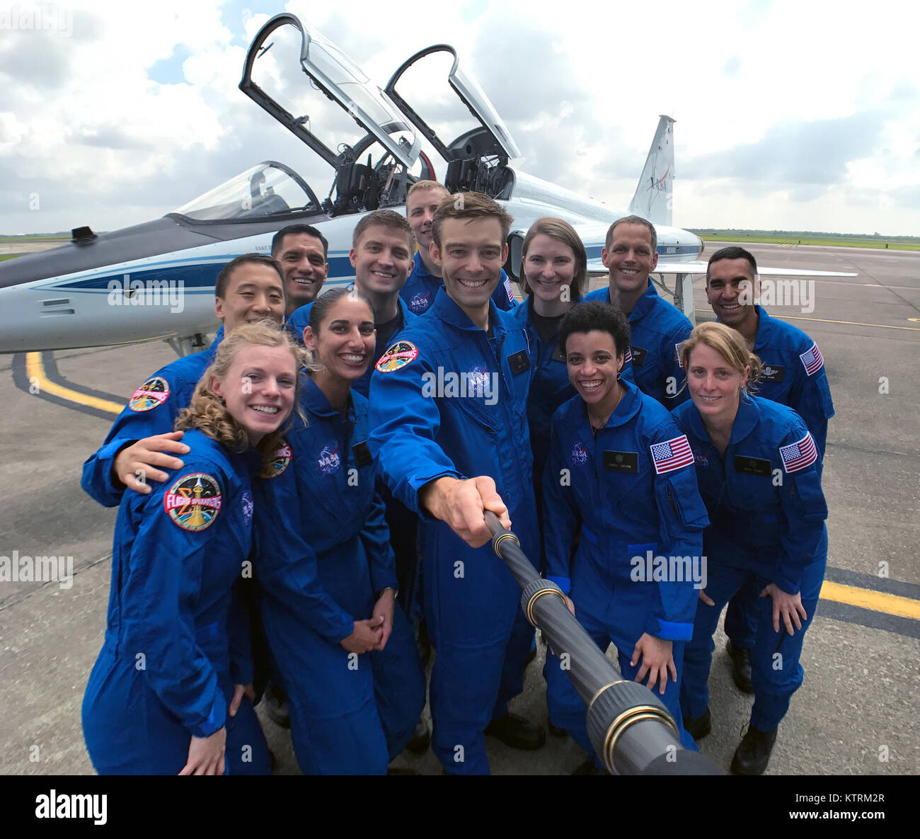 NASA's 2017 astronaut candidates stop to take a group photo while getting fitted for flight suits at Ellington - Stock Image