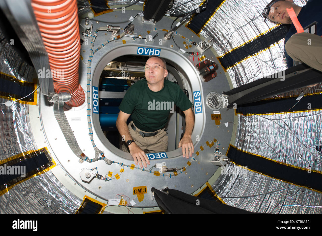 NASA astronaut Randy Bresnik looks through the hatch of the International Space Station's Bigelow Expandable - Stock Image