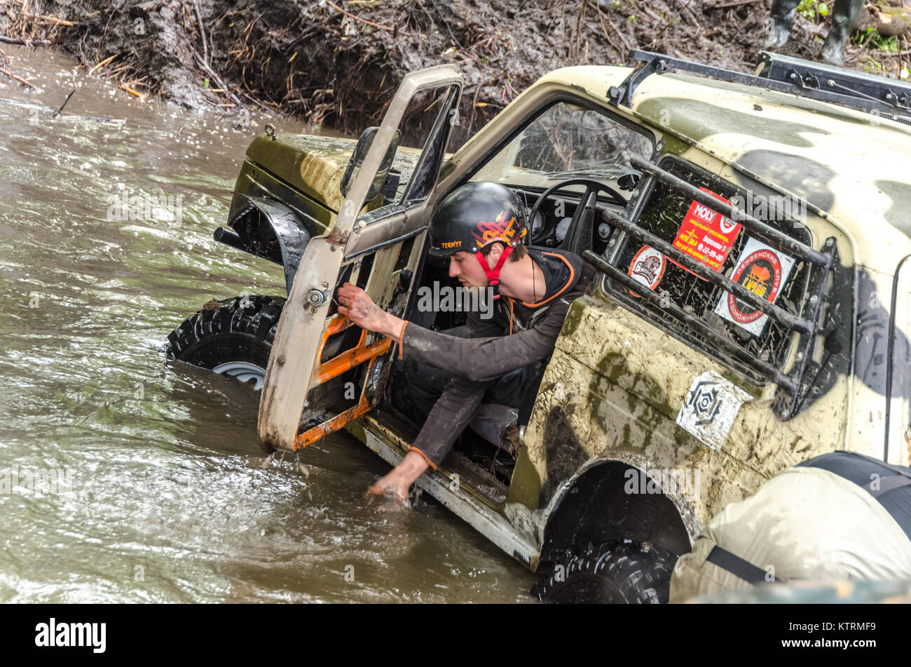 SALOVKA, RUSSIA - MAY 5, 2017: Four-wheel dirve crosses the mud obstacle on the distance of racing - Stock Image