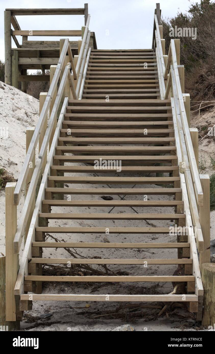 Wooden staircase leading up away from the beach. Stock Photo