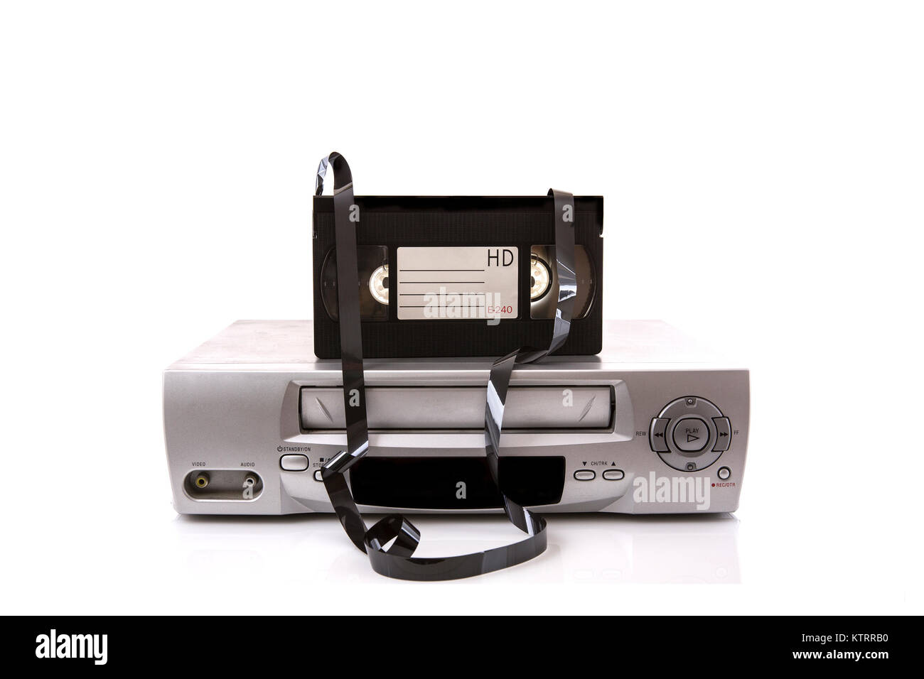 Old VHS Video recorder with tape on a white background with copy space - Stock Image