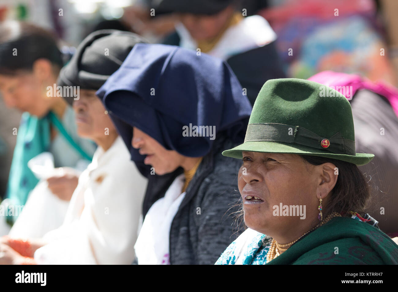 Otavalo, Ecuador-December 23, 2017: indigenous people sitting outdoors in the local market - Stock Image