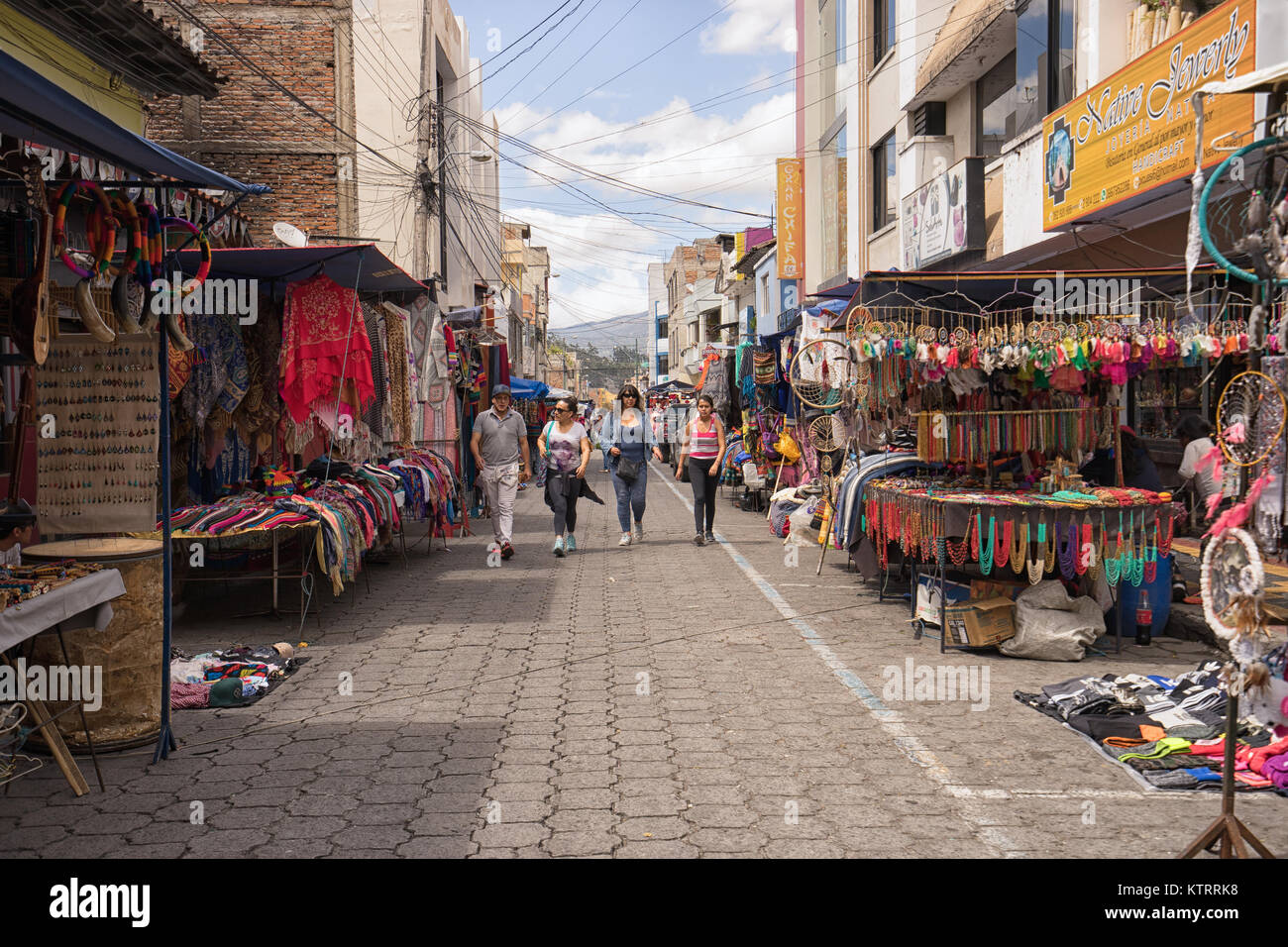 Otavalo, Ecuador-December 23, 2017: vendor stands set up on the street of the indigenous town on the traditional - Stock Image
