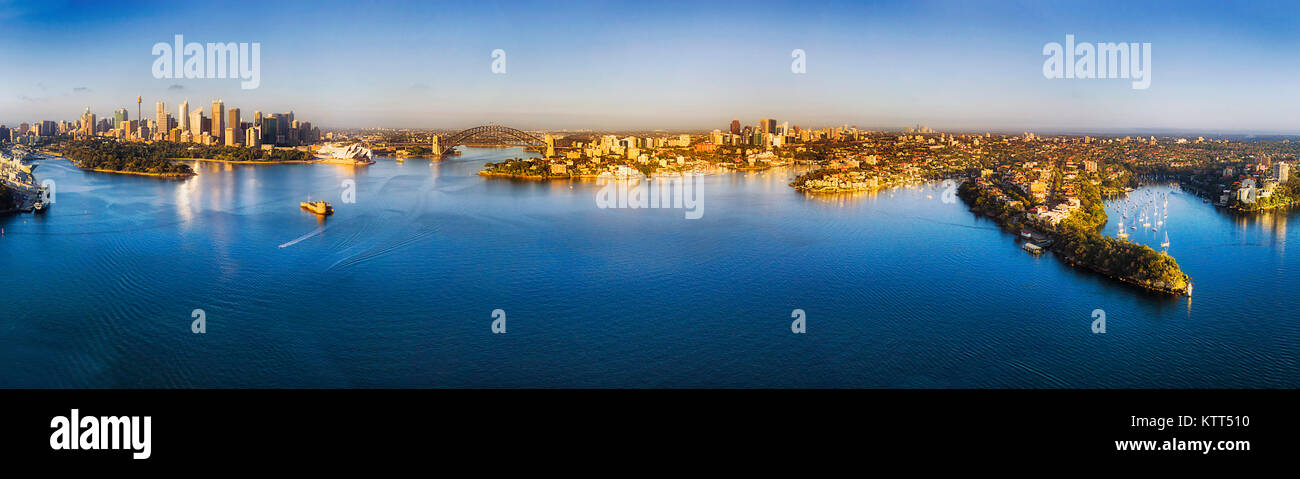 Wide panorama of Sydney harbour from Woolloomooloo through city CBD landmarks to Lower north shore wealthy suburbs - Stock Image