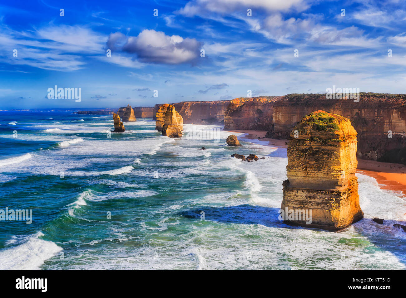Disconnected eroded limestone rocks of twelve apostles rock formation in marina park on the Great Ocean road during - Stock Image