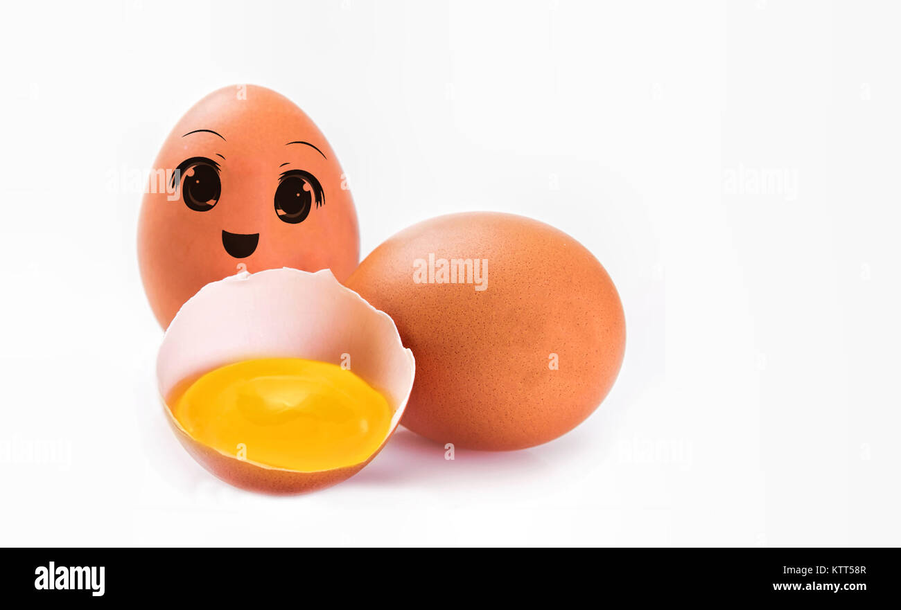 An egg with a happy smiley face with other eggs - Stock Image