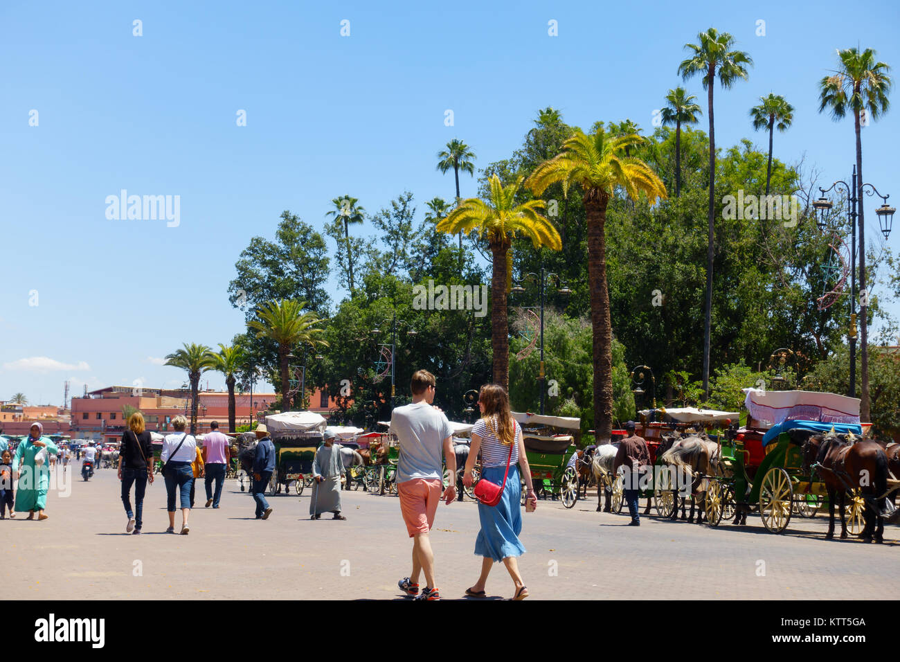 Marrakech, Morocco - May 12, 2017: Tourists and locals are walking on the street leading towards the famous Jemaa Stock Photo