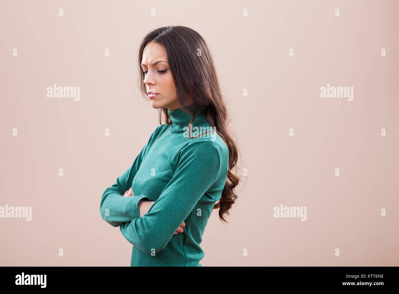 Portrait of displeased and angry woman - Stock Image