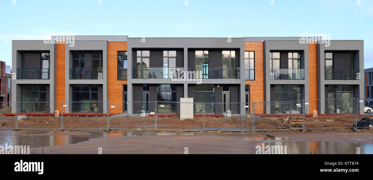 Panorama of a modern standard unfinished houses buildings Stock