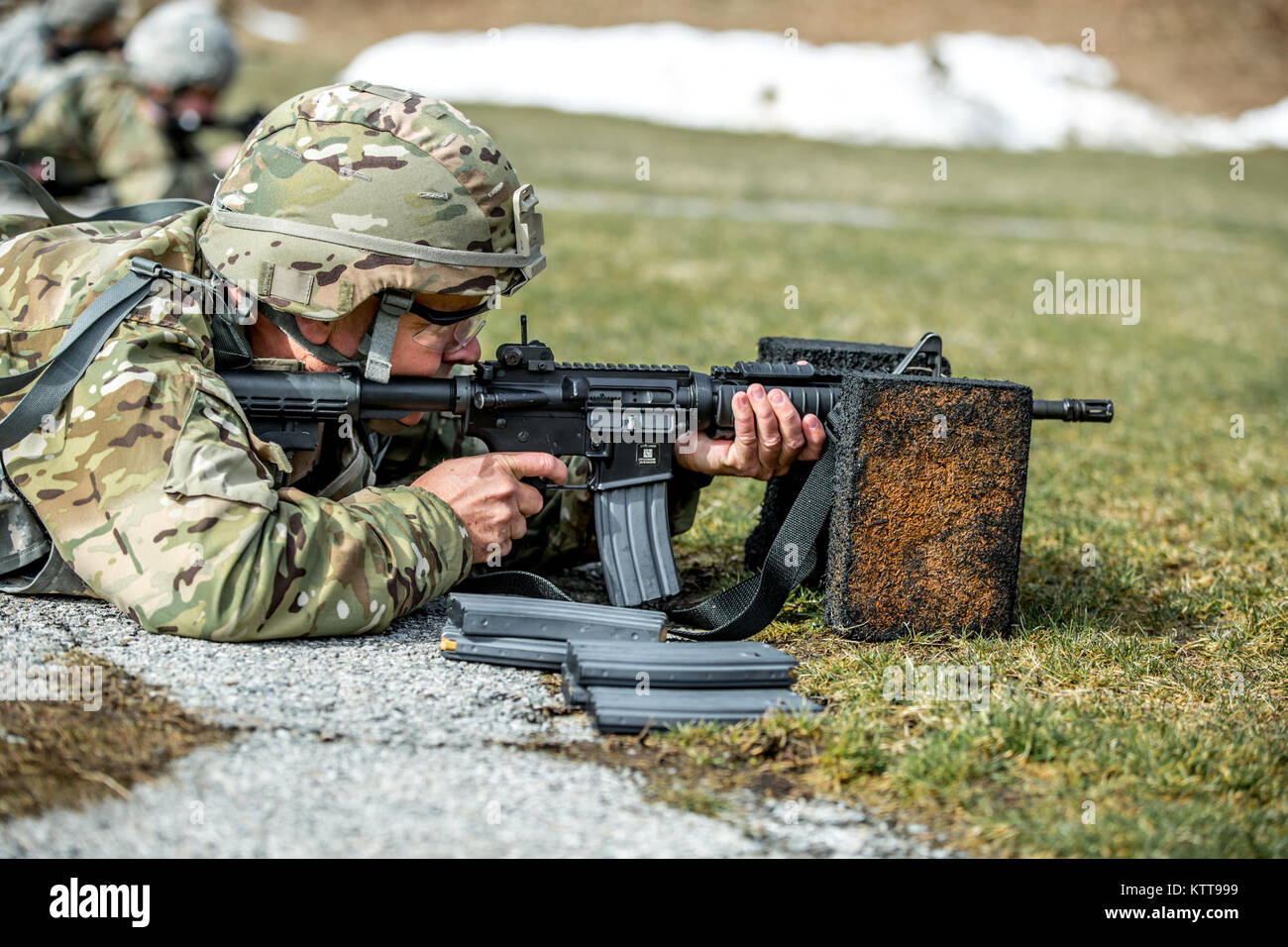 U.S. Army Sgt. 1st Class Jeffrey Mason zeroes his weapon before shooting a weapon qualification during the New York Stock Photo
