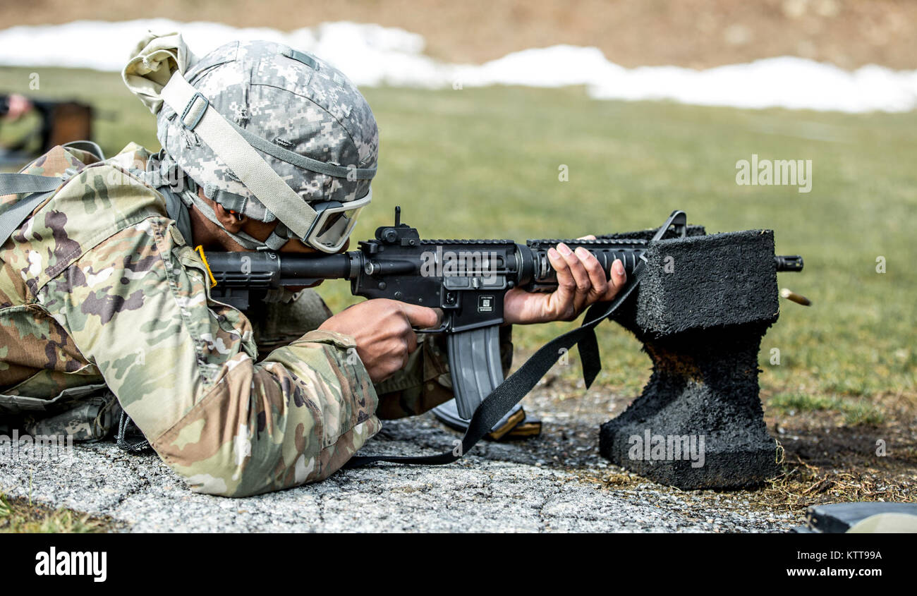 U.S. Army Spc. Richard Blount zeroes his weapon before shooting a weapon qualification during the New York Army Stock Photo