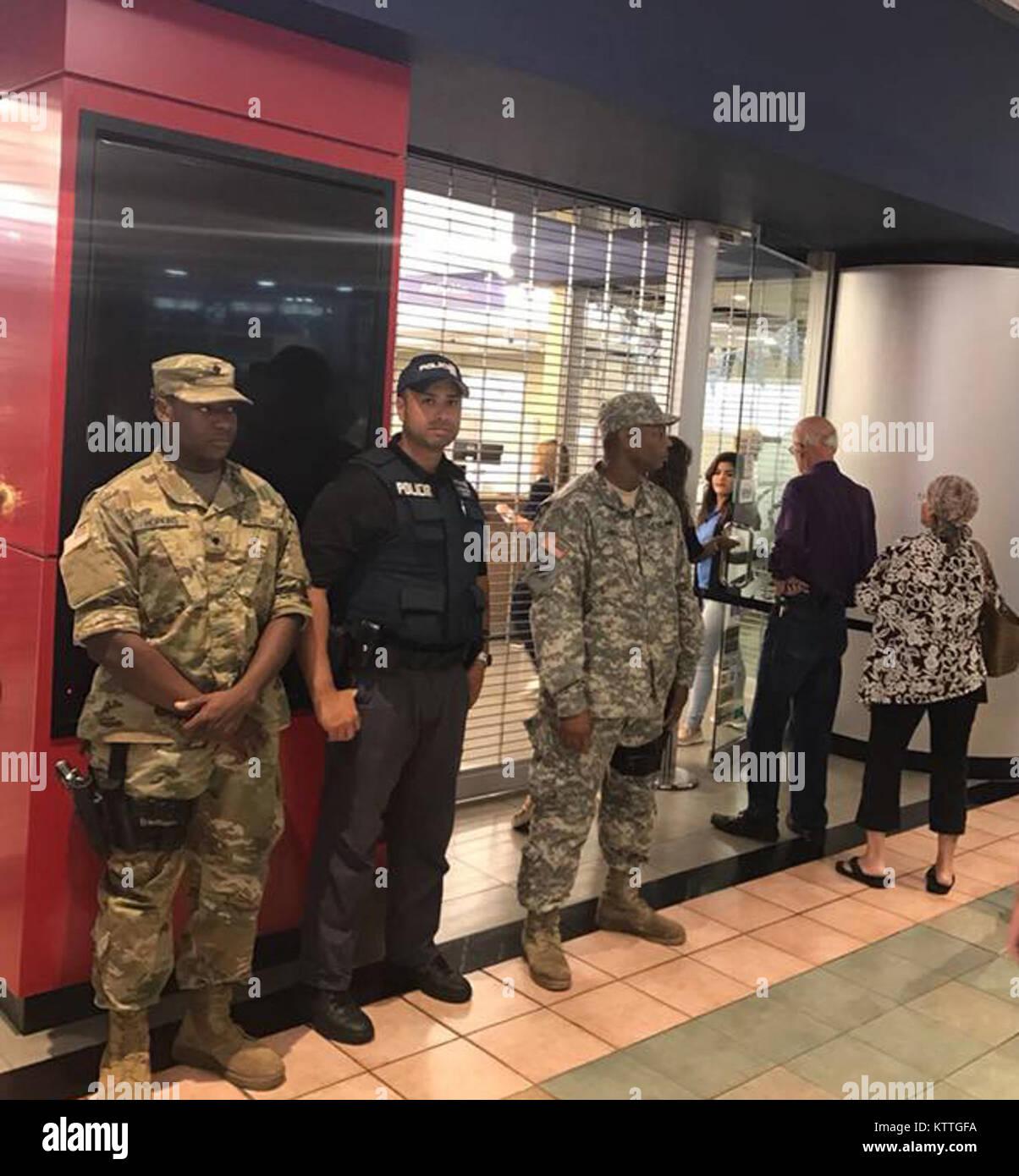 New York Army National Guard SPC Malachi Hopkins and Sgt. Desmond Hall provide security alongside a San Juan Puerto - Stock Image