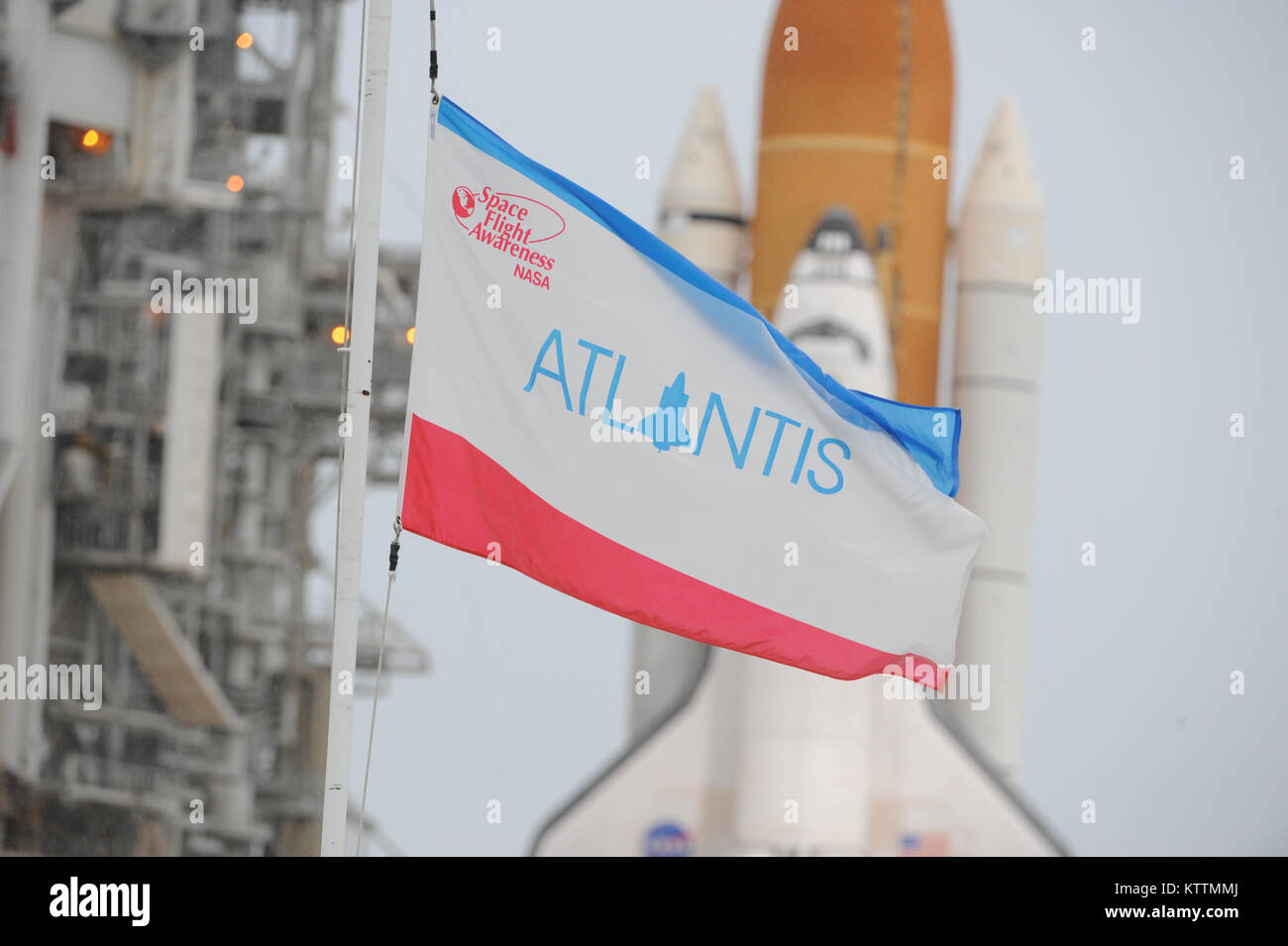 Atlantis sits on launch pad 39A, 1 day before taking it's final flight. A crowd of almost a million people packed - Stock Image