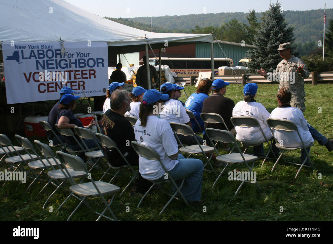 New York Army National Guard Sgt. 1st Class Frank Rizzi briefs volunteers before missions in Prattsville, N.Y. Sep. Stock Photo