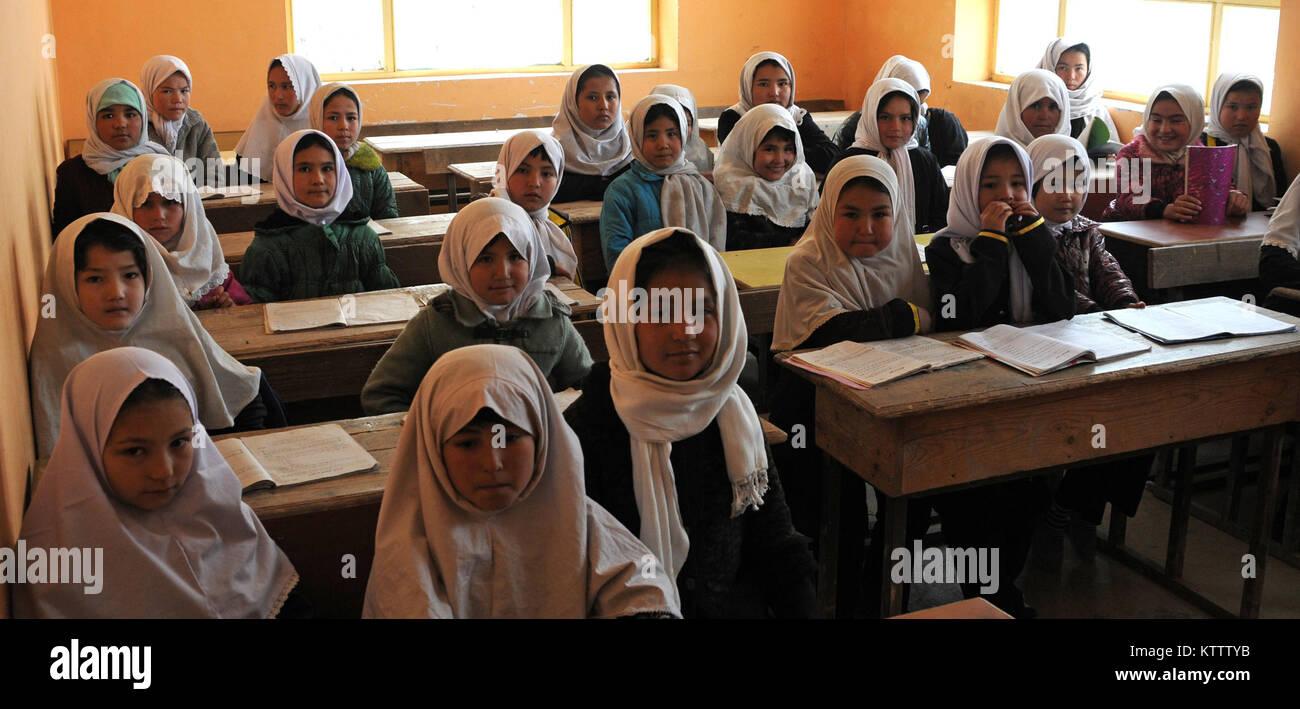 Young Afghan girls sit in their Aliabad School classroom near Mazar-e-Sharif, Afghanistan, March 10, 2012. Their - Stock Image
