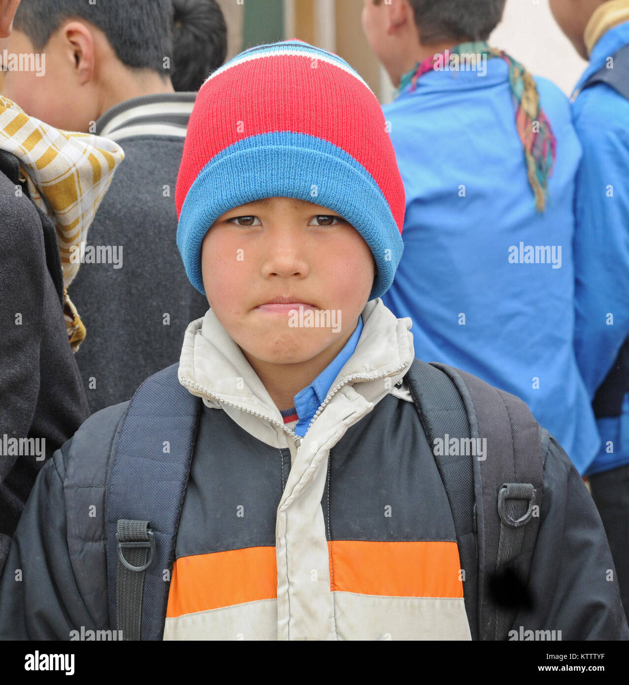 A young Afghan boy stands outside of the Aliabad School near Mazar-e-Sharif, Afghanistan, March 10, 2012. Their - Stock Image