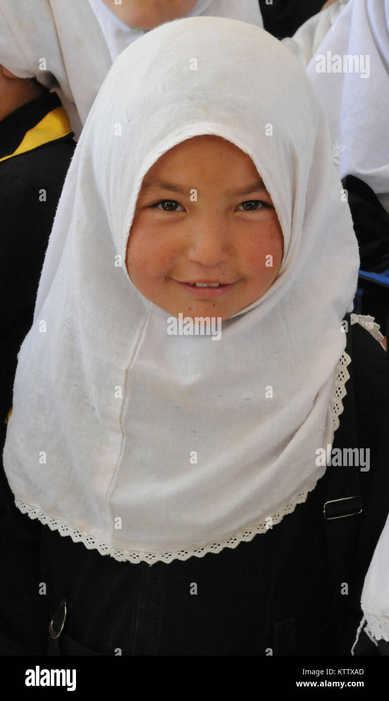 A young Afghan girl sits in class at the Aliabad School near Mazar-e-Sharif, Balkh Province, Afghanistan, April Stock Photo