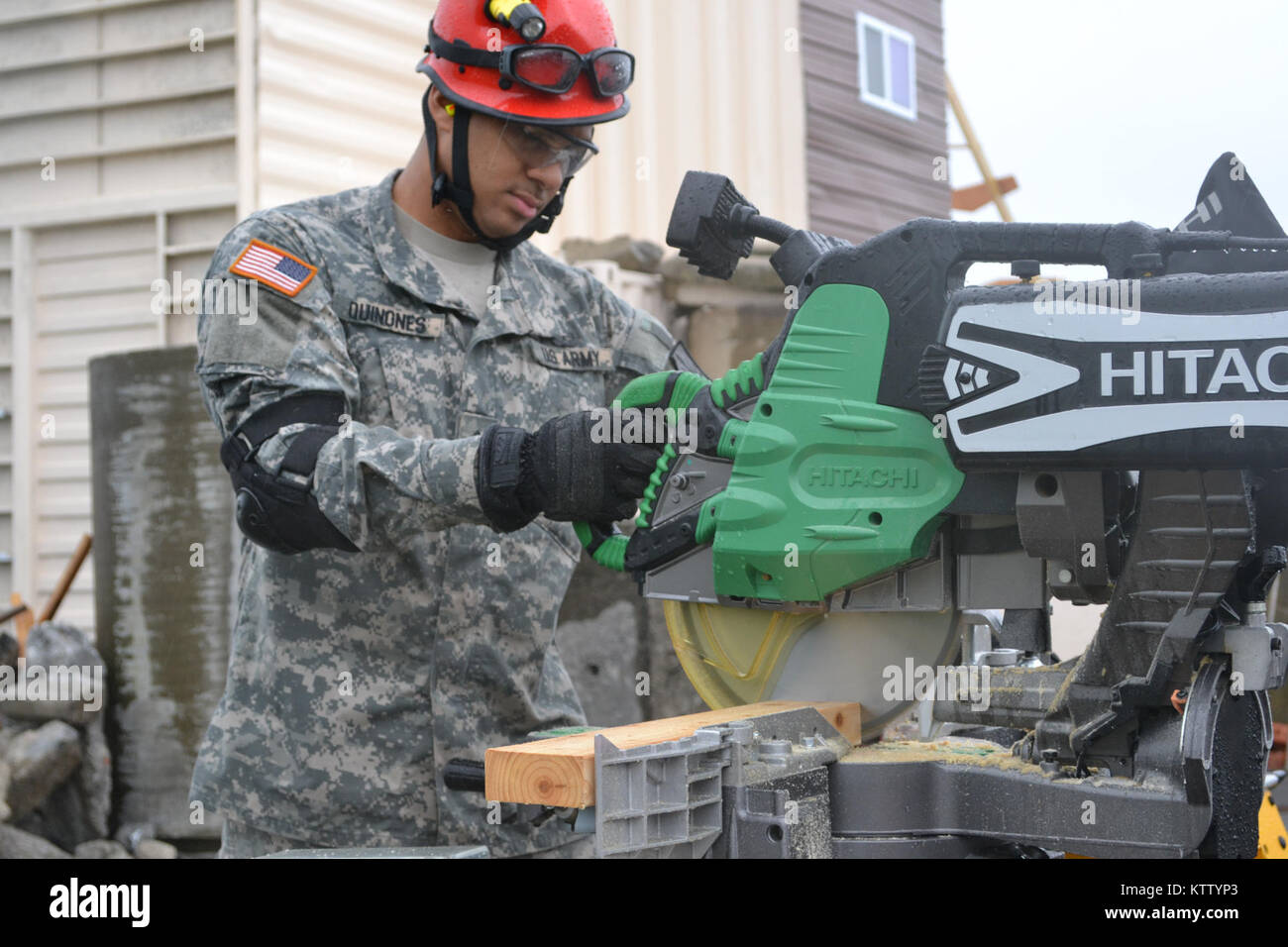 Oriskany, NY -- Sgt. Unique Quinones, a member of the 1156 Search and Extraction Team is seen cutting a plank of - Stock Image