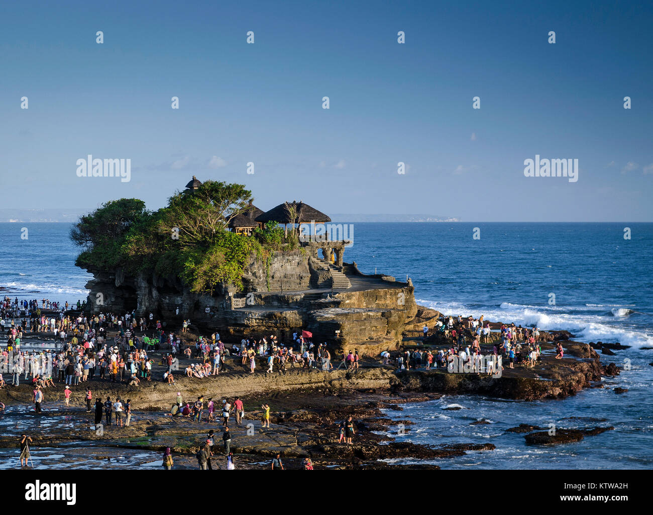 pura tanah lot famous balinese temple landmark on bali island coast indonesia at sunset - Stock Image