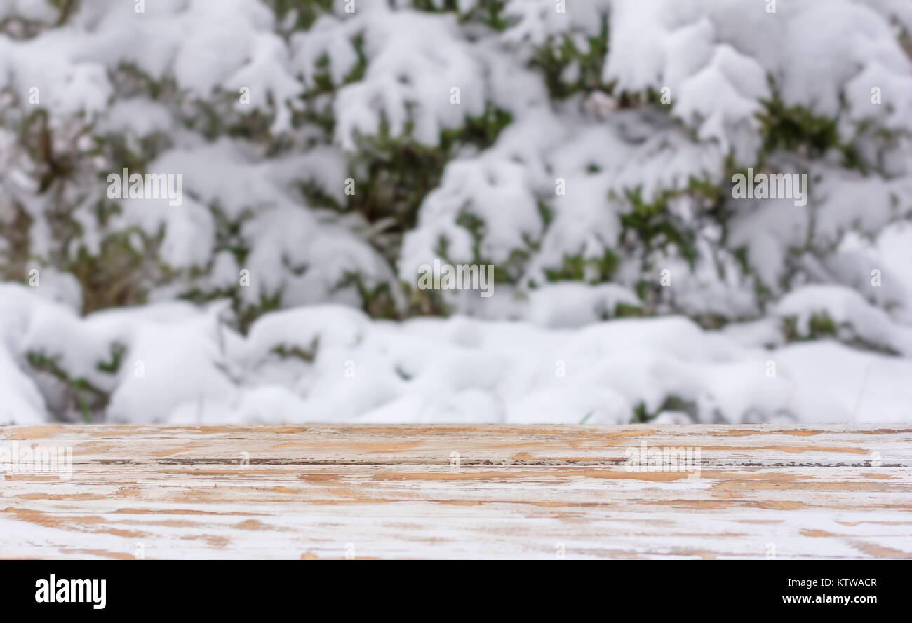 natural blurred winter background with a wooden table and a mounting area for the placement of objects. mock up - Stock Image