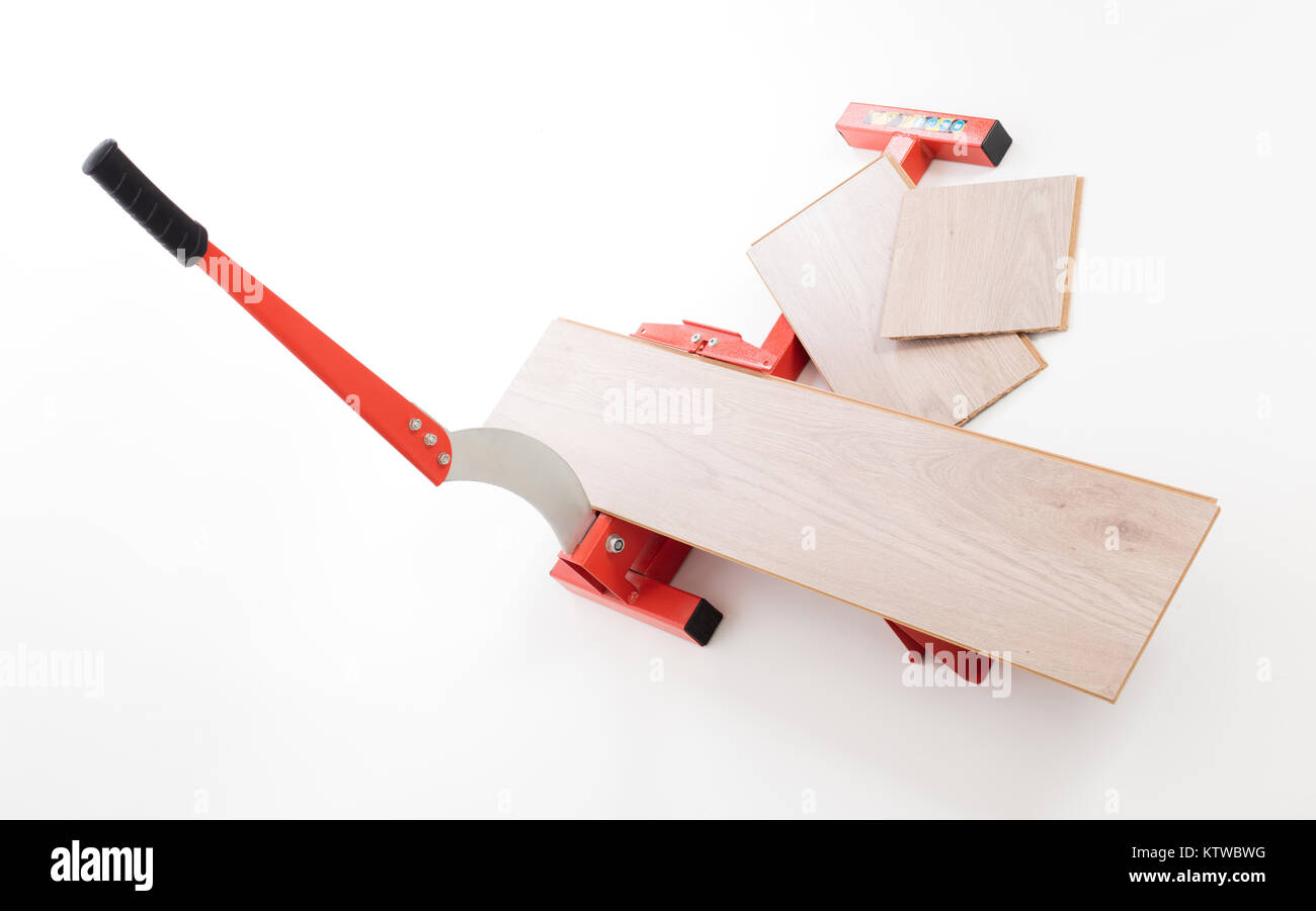 Red tool for cutting laminate, isolated on white - Stock Image