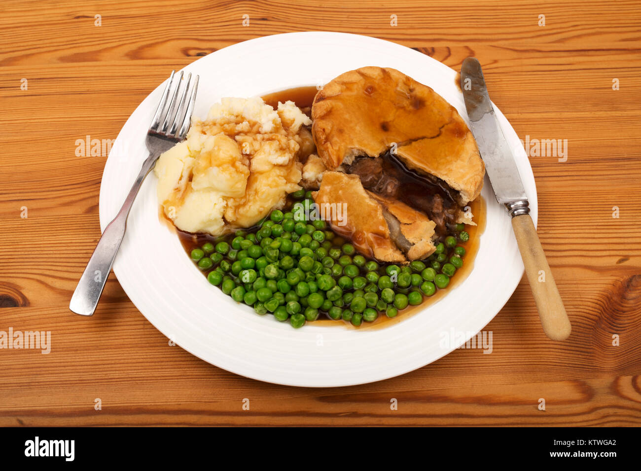 Steak pie, mashed potatoes peas and gravy Stock Photo ...