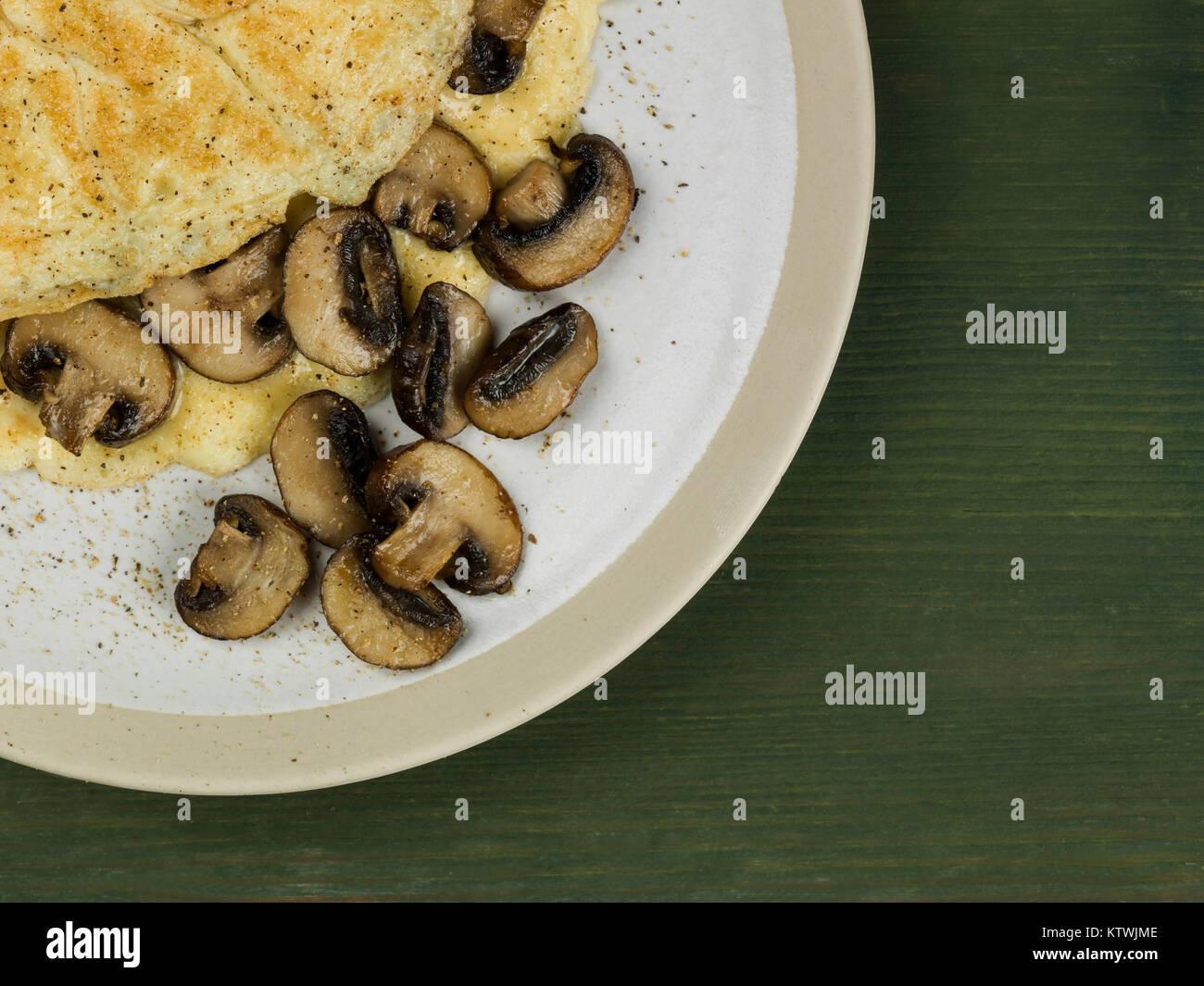 Freshly Cooked Healthy Mushroom Omelette For Breakfast or Lunch - Stock Image