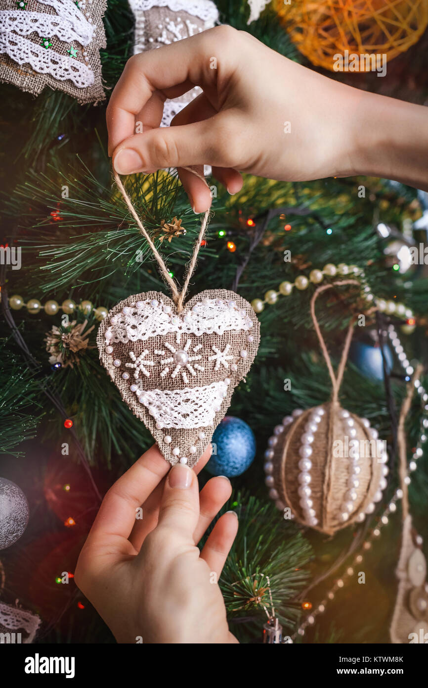 Hipster hands with Christmas sackcloth heart Stock Photo