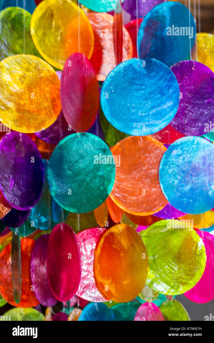 Colourful painted shell decorations - Stock Image