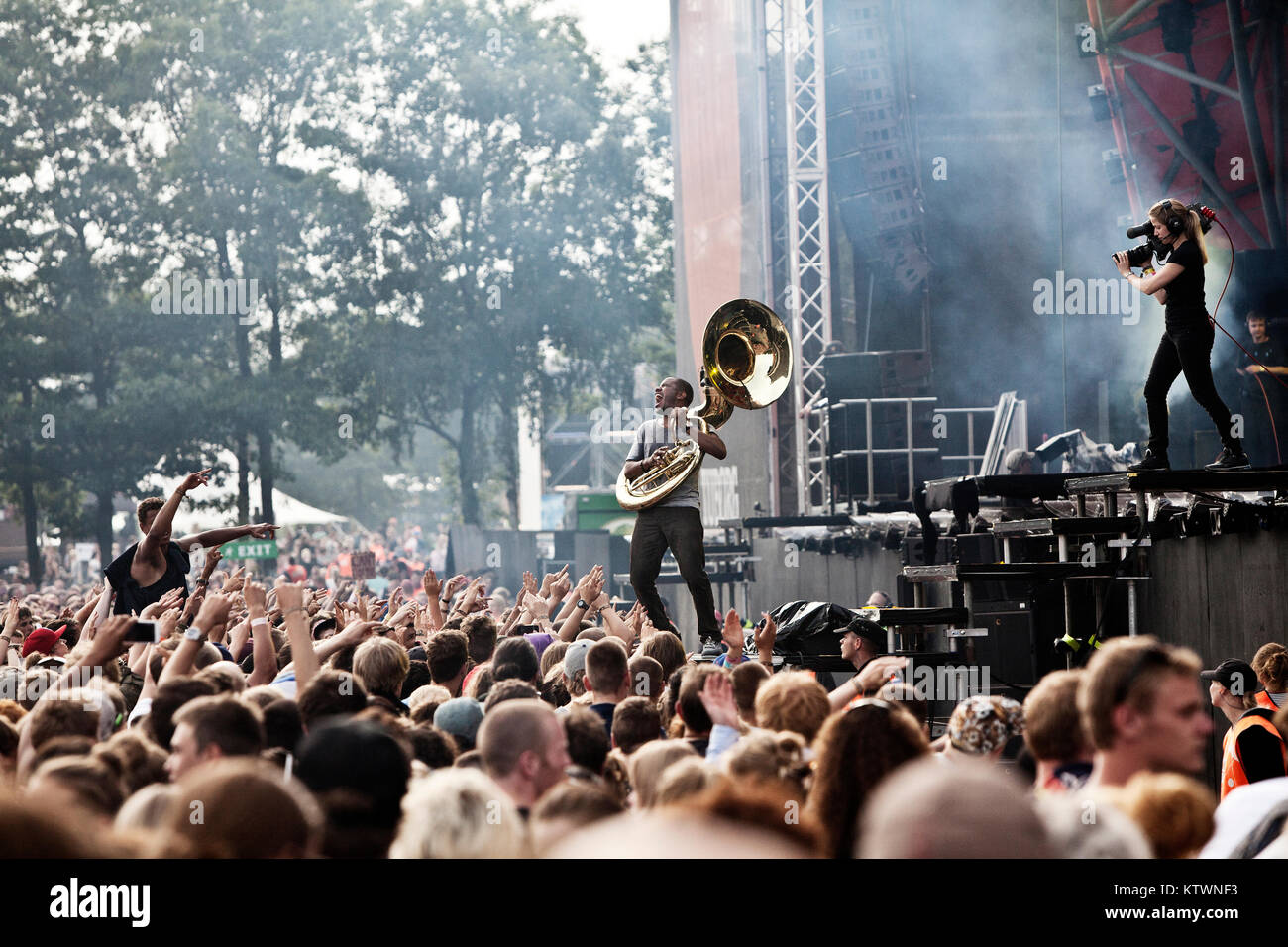 The American hip hop, rap and soul band The Roots performs a live concert at Roskilde Festival 2012. Here the musician Stock Photo
