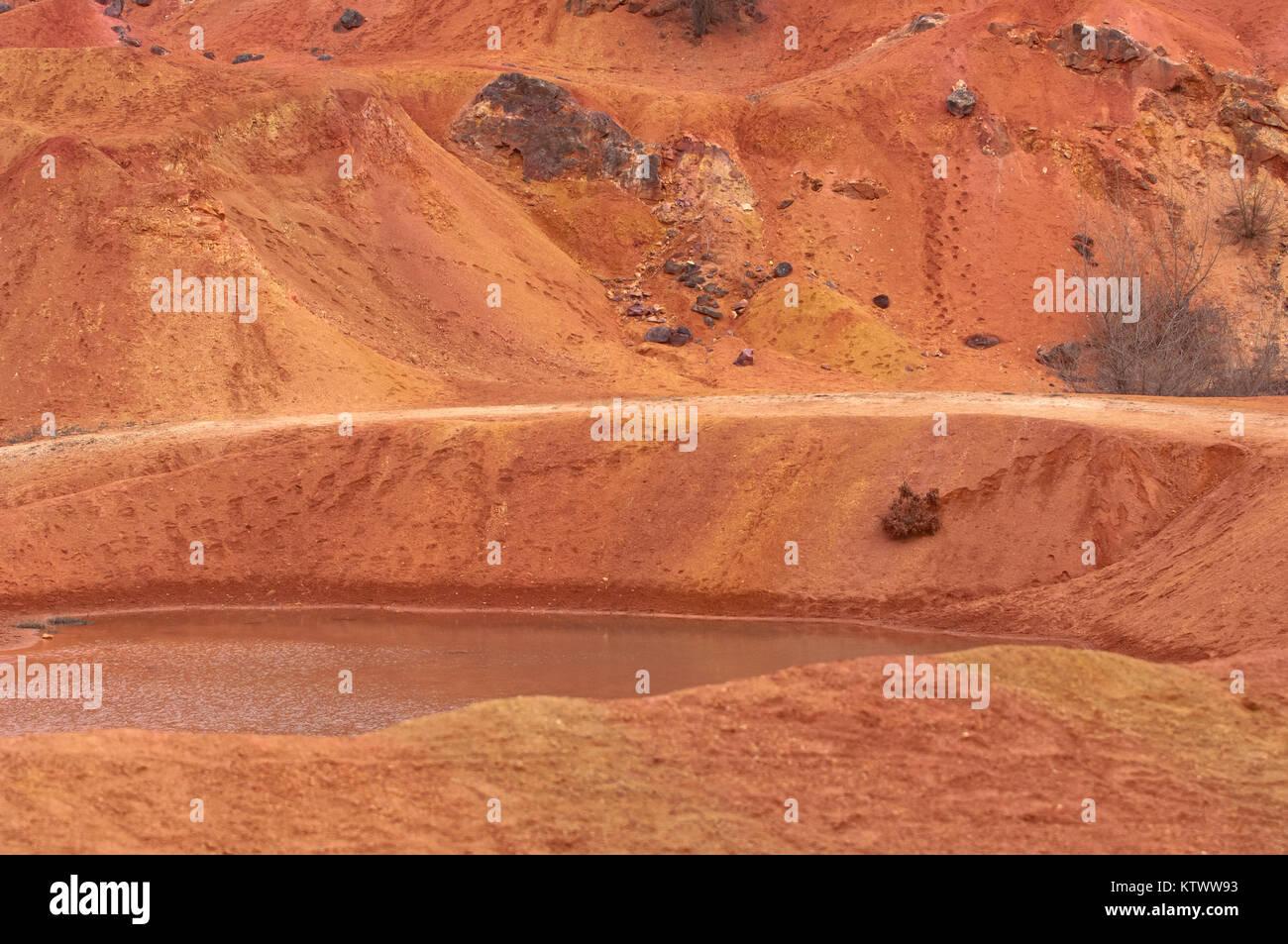 Bauxite mine, raw weathered bauxite sedimentary rock on surface - Stock Image