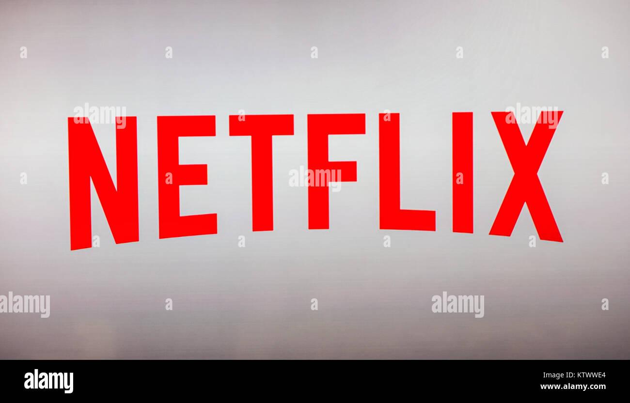 Netflix logo on a TV screen  Netflix app on Laptop screen  Netflix
