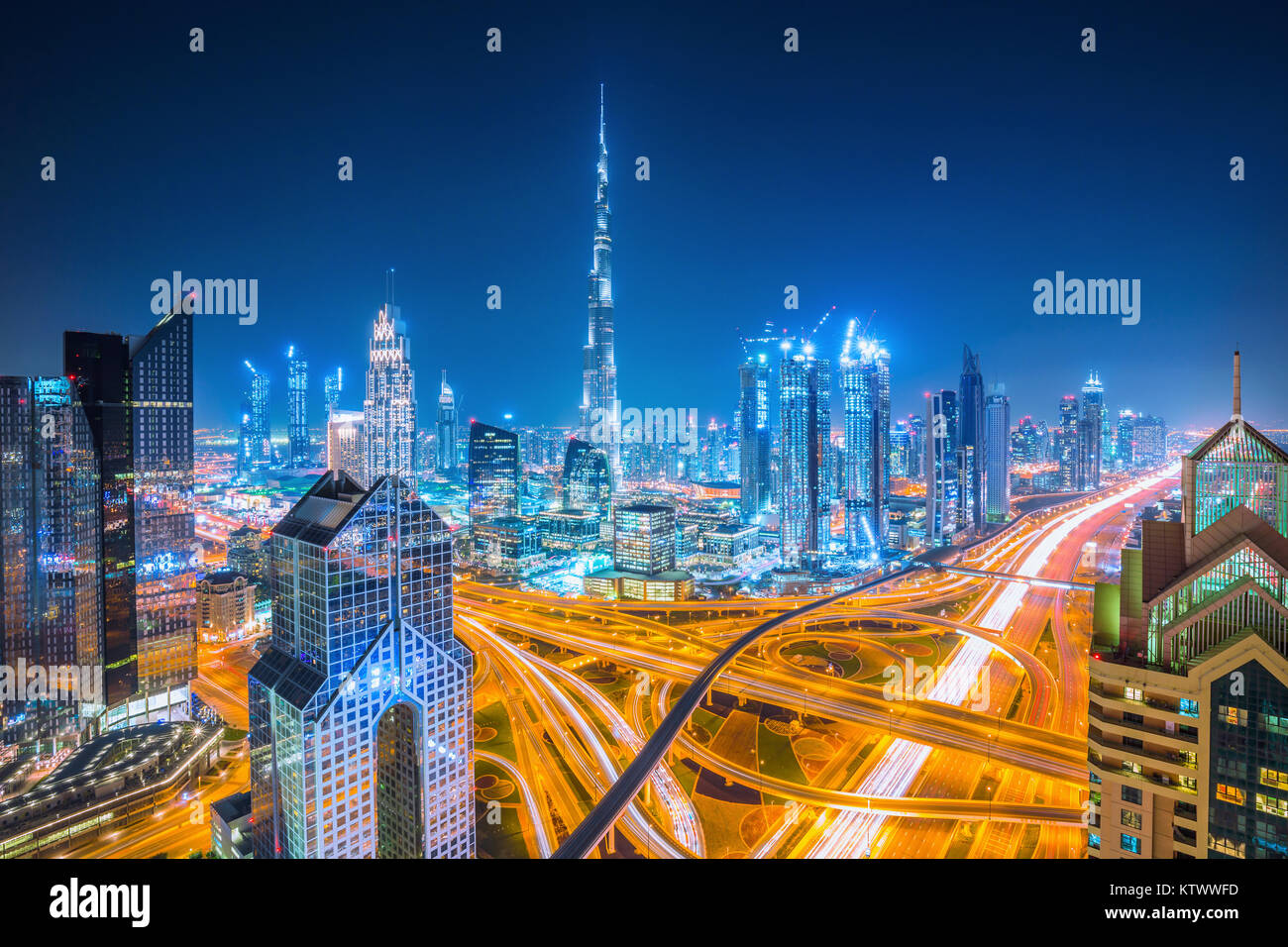Dubai skyline at sunset with beautiful city center lights and Sheikh Zayed road traffic,Dubai,United Arab Emirates - Stock Image