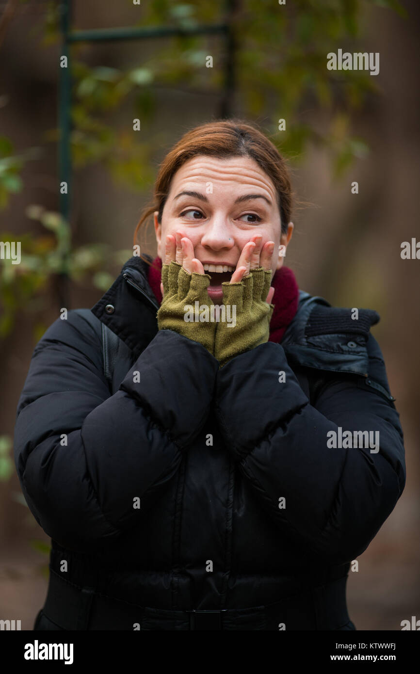 Suprised, Woman Outdoor shots in Park, Winter - Stock Image