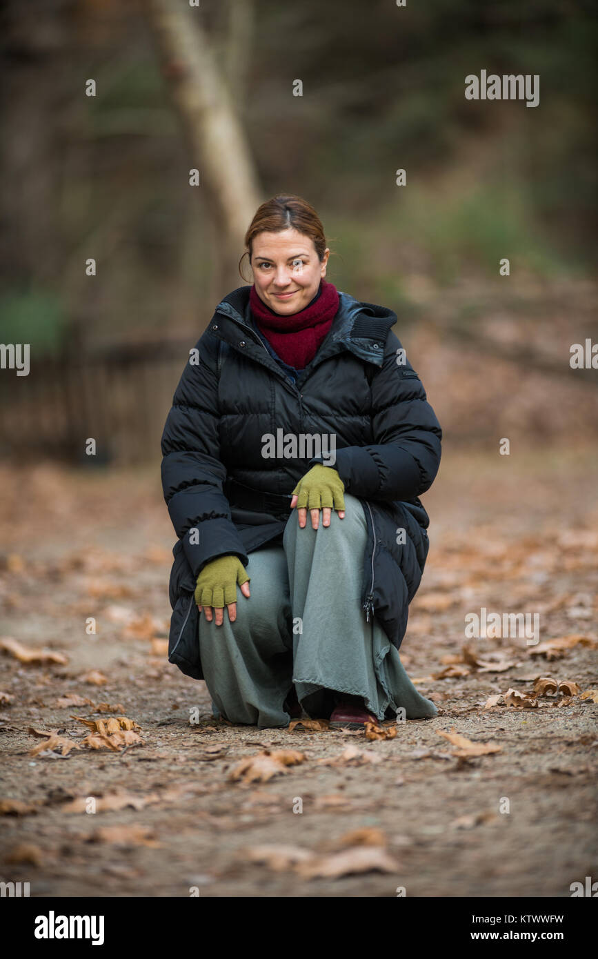 Woman Outdoor shots in Park, Winter - Stock Image