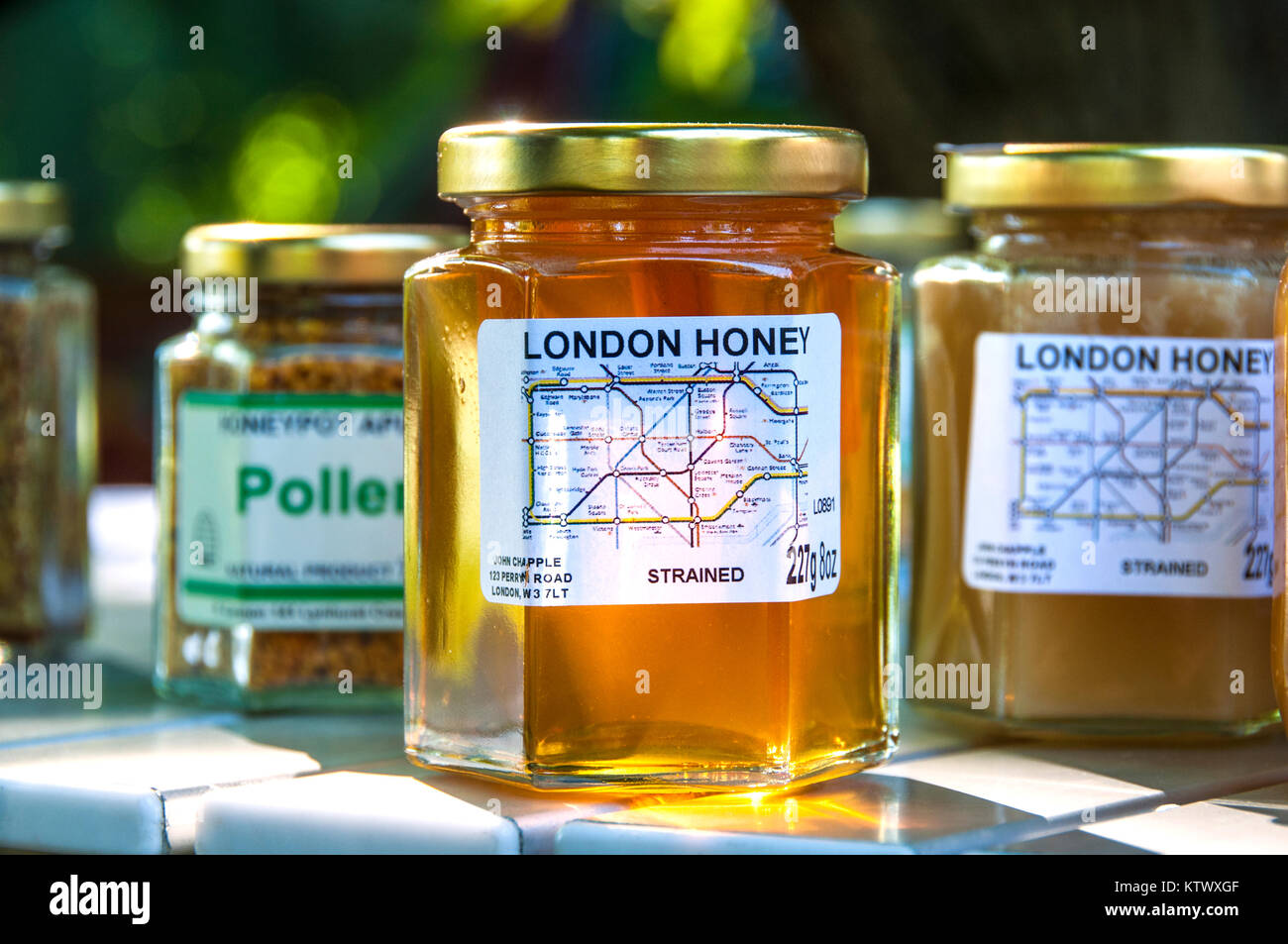 London Honey jars (strained) with Underground Tube Map Label and Pollen jars on sale at Farmers Market Stall Lambeth - Stock Image