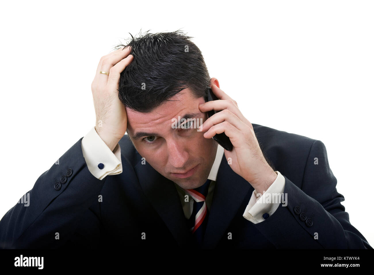 A businessman worries about bad business news or crisis - Stock Image