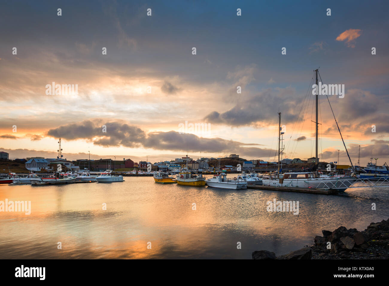 Stykkisholmur harbour at sunset. Stykkisholmur is a town situated in the western part of Iceland, in the northern Stock Photo