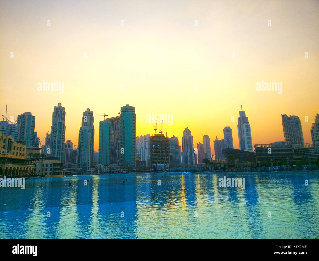 A view of the buildings in Dubai from the Dubai Fountain near the Burj Khalifa - Stock Image